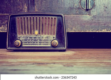 still life with retro radio on the floor in old house.