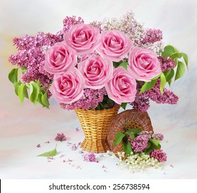 Still life with roses and lilac flowers on artistic background