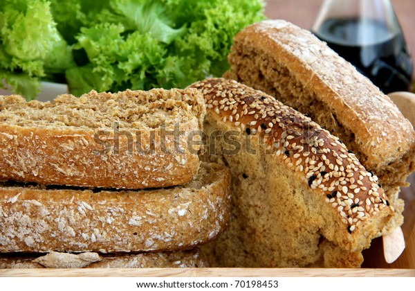 Still life  with rusk ,bread,Butter Lettuce on wooden background