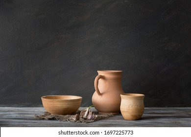 Still life in a rustic style. Set of ceramic dishes on a wooden table.