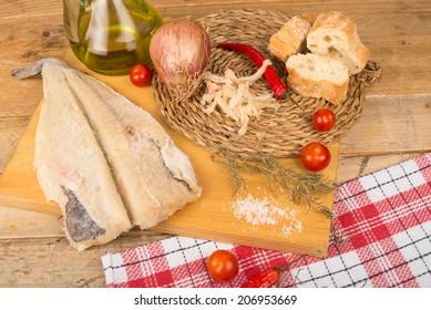Still life with salt cured cod fish and Mediterranean ingredients