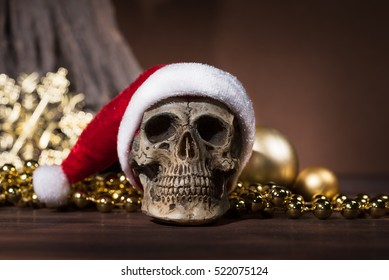 Still life with santa claus skull with gold christmas balls and golden ornament with copy space, Merry xmas and Happy new year 2017 concept