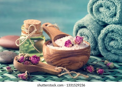 Still life with sea salt with dry rose petals