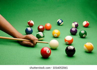 A STILL LIFE OF A SET OF SNOOKER/POOL BALLS  ON A SNOOKER/BILLIARDS TABLE