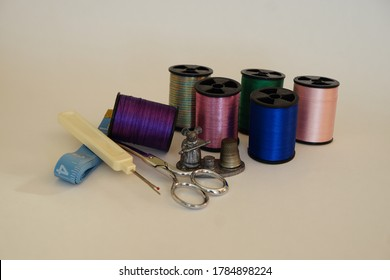 Still Life of Sewing Notions Thread, Thimble, Scissors, Seam Ripper and MeasuringTape