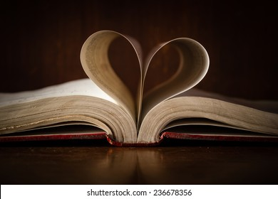 Still life with sheets of a book heart shaped