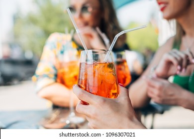 Still life shot of woman hand holding summer cocktail