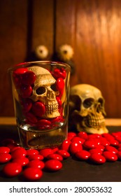 still life with skull and  red medicine on abstract background