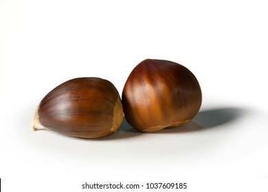 Still life of some chestnuts on a white background.