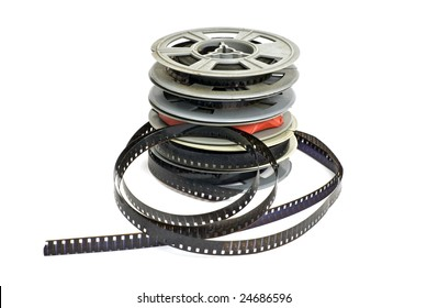 still life of stack of dirty, old 8mm cine film and reels; isolated on white ground