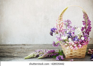still life with summer flowers in basket
