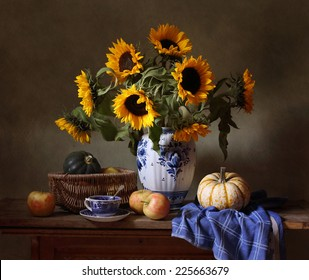 Still life with sunflowers, apples and pumpkins