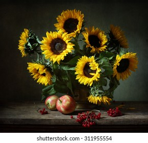 Still life with sunflowers and apples (textured for artistic effect)