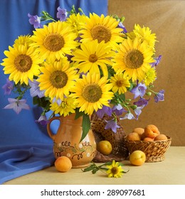 Still life with sunflowers and fruits on artistic background