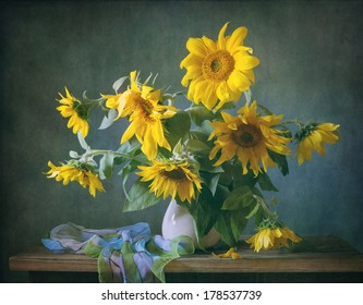 Still life with sunflowers and a shawl