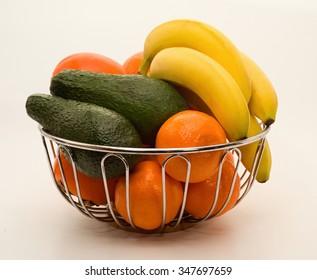 Still life with tangerines, bananas, avocado and diasporas