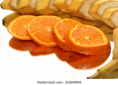 still life the tangerines and bananas cut on segments
