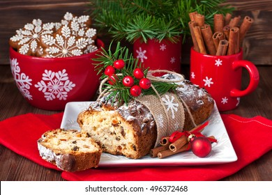 Still life with tasty cake portion. Christmas stollen with several ingredients