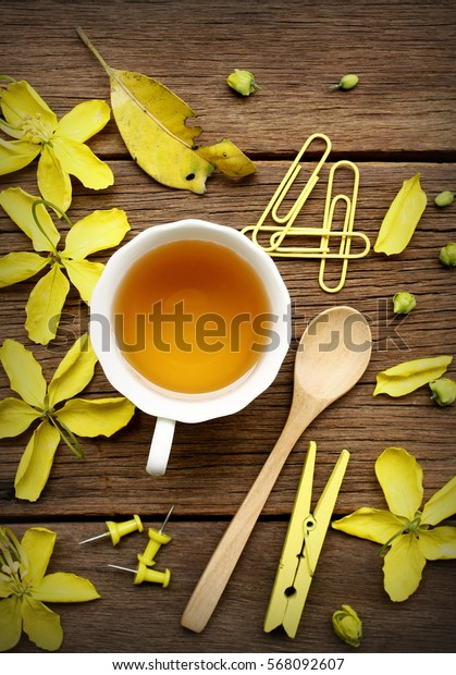 still life with tea cup and the contents of a workspace composed. Different objects on wooden table.Flat lay.(selective focus)