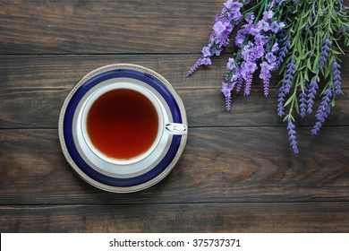 Still life with tea cup on saucer and lavender. Top view.