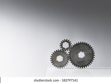 Still life with three old cog gears. Lots of copy space.