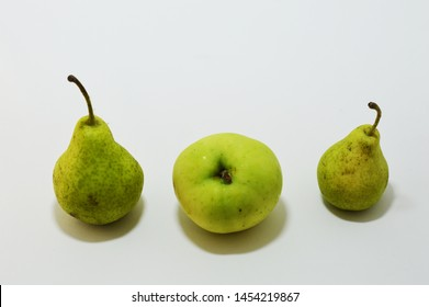 Still life with three tasty fruits. Two pears and one apple isolated. Fruits on white background.