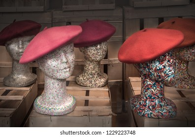 """Still life of Traditional hat in Basque Country, call """"Benet"""" or """"boina"""", at Spain, on wooden boxes. Vintage style."""