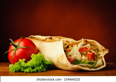 still life with traditional homemade shawarma and vegetables