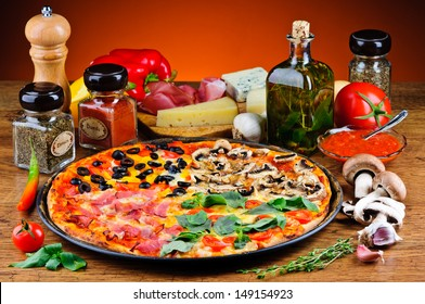 still life with traditional quattro stagioni pizza and ingredients