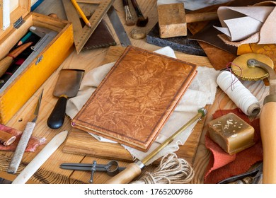 Still life of various tools for the craft of hands binding book