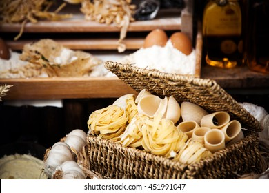Still life with various traditional italian pasta and ingredients