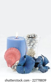 Still life of vase, candle, flowers
