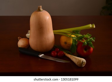 Still life with vegetables and knife.
