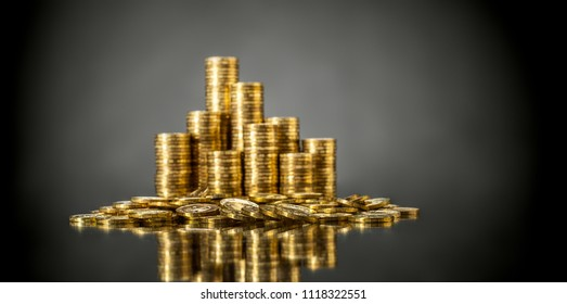 still life of very many rouleau gold  monetary or change coin, on grey background