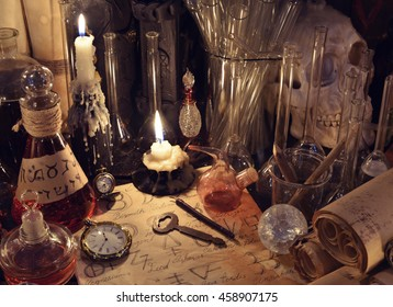 Still life with vintage bottles, key, magic objects and scrolls. Old pharmacy, medieval alchemy or witch laboratory. There is no foreign text in the image, all symbols are imaginary and fantasy ones.