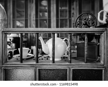 Still life of vintage coffee grinder, coffee cup, coffee pot at barista counter in tradition cafe
