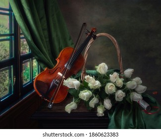 Still life with violin and delicate roses