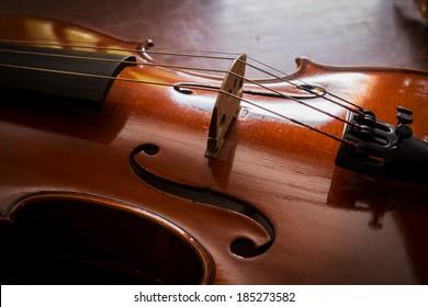 Still life violin on wood table.
