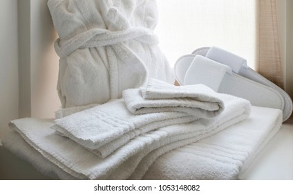 still life of white linen set for bathroom