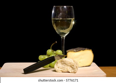 still life of white wine, cheese and bread