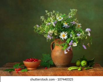 Still life with wildflowers and red currants
