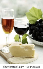still life with  wine glass, cheese and grapes