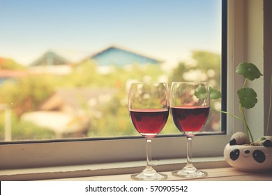 Still life of Wine Glass with window.