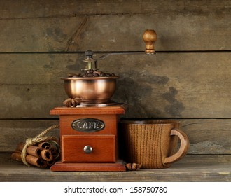 Still life of wooden coffee grinder cinnamon sticks and star anise