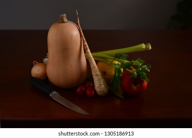 Still life wtih vegetables and knife close up.