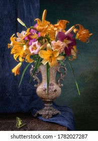 Still life with yellow lily and day lily flowers