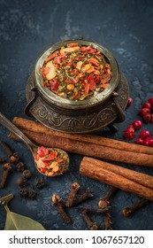 Still life.Composition with different types of spices with bright colors over dark stone background. Colorful spices. Organic food, healthy lifestyle, space for text