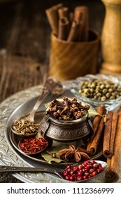 Still life.Composition with different types of spices with bright colors on rustic wooden table. Colorful spices. Organic food, healthy lifestyle, space for text