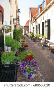 still live of village street with street furniture and flowers, pots and pans