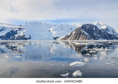 Still waters and the snowcapped mountains in Antarctica